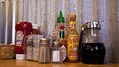 024011-53-Table of Condiments-1 (Jim an' I'm the 'Real McCoy') Tags: pictures food pepper photography resta