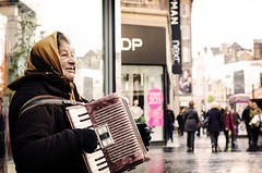 Playing for survival (Explored) (BusyBee-cr) Tags: life street city portrait playing lady liverpool shopping busking merseyside