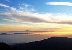 Basking in the Heavens (astaarael) Tags: light sunset sun sunlight mountains fog clouds landscape heaven paradise beam ridge fade rim heavens