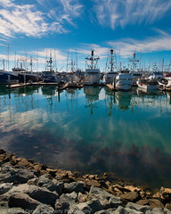 fishing boats in San Diego harbor (richd77) Tags: ocean sea reflection water clouds reflections boats harbor boat sandiego
