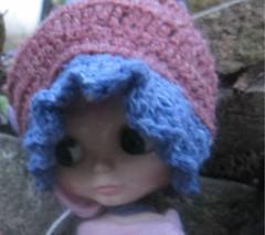 Melissa in her blythe sized crocheted bonnet