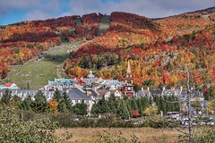 Mont Tremblant and the color palette (beyondhue) Tags: mont tremblant ski resort village beyondhue color autumn fall season quebec laurentians laurentides mountain hill canada lift clocktower architecture sunny cloud