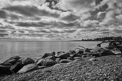 The lake BnW (AudibleQuest) Tags: lightroom fullframe sonyalpha photography daylight landscape nature seascape water blackandwhite rocks
