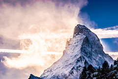 Matterhorn series - Light striked stormy Matterhorn (redgoldish) Tags: matterhorn switzerland zermatt backlight snow mountain winter snowstorm clouds landscape cold perspective