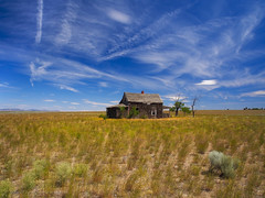 High Desert Days Gone By (RobertCross1 (off and on)) Tags: 1250mmf3563mzuiko bend deschutes em5 omd or olympus oregon pacificnorthwest sisters abandoned architecture bluesky clouds desert highdesert house landscape shack