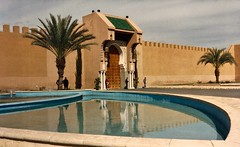Portugal/Morocco (11) (The Spirit of the World) Tags: palace pool reflectingpool palms palmtrees trees guards entrance morocco royalty king marrakesh reflections 1986 northafrica africa film print analogphotography