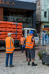 Love My Blue Hard Hat (Jocey K) Tags: newzealand christchurch buildings city signs architecture people street newregentst cafes chairs tables shops mural streetart painting artwork truck roadmakersx