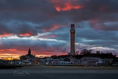 Provincetown sunset (betty wiley) Tags: capecod provincetown pt ptown sunset storm pilgrimmonument bettywileyphotography massachusetts coastal town skyline holiday lights dusk newengland beach wharf tower monument christmas