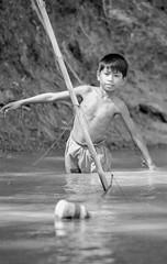 Laos : portraits #13 (foto_morgana) Tags: analogphotography analogefotografie asia boat boy child childhood indochina jeugd jeune jeunesse jong juventud kid laos lightroom mekongriver nikoncoolscan outdoor photographieanalogue travelexperience vuescan water young youth