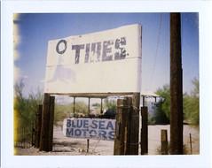 Ehrenburg, AZ (moominsean) Tags: arizona polaroid desert tires instant 190 ehrenburg type690 expired022008 blueseamotors