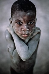 Mccurry (GaiaPernati) Tags: africa boy portrait dusty vertical standing naked nude outside outdoors stand kid exterior child mud african 1987 young powder dirty dirt cover covered dust mali timbuktu covering armscrossed nyc9468 mcs1987002k100 africa10018 0005503 mali10004