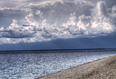 Great Lake (illusionsofgrandeur) Tags: trip travel blue summer vacation cloud lake beach water clouds rocks michigan lakes lakemichigan greatlakes ripples hdr greatlake