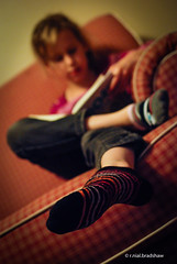 reading-girl-couch-socks.jpg