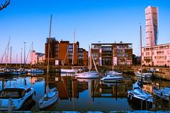 Reflection (Maria Eklind) Tags: cityview city skymmning bridge buildings malm boats street reflection spegling sweden streetview vstrahamnen turningtorso dusk skneln sverige se