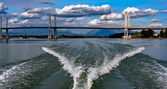 Whale Tail (Images by Christie  Happy Clicks for) Tags: wake boatwake boat water river fraserriver goldenearsbridge bc canada infrastructure clouds sky mountains