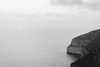 Sun setting (lorenzoviolone) Tags: bw blackwhite blackandwhite d5200 dslr fujifp3000b monochrome nikon nikond5200 reflex seascape sunset vsco vscofilm cliffs cliffside clouds horizon horizononthewater streetphoto streetphotobw streetphotography sun sunsetting travel:malta=aug2016 siggiewi malta fav10