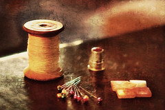 small sewing repairs... (clo dallas) Tags: repairs riparazioni sewing cucito stilllife texture bottoni spilli rocchetto ditale buttons pins spool thimble oilpaint sony