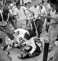 #18-year-old Keshia Thomas protects a fallen man, believed to be associated with the Ku Klux Klan from an angry mob of anti-clan protestors. Ann Arbor, Michigan USA. 1996. By Mark Brunner [980 x 1030] #history #retro #vintage #dh #HistoryPorn http://ift.t (Histolines) Tags: histolines history timeline retro vinatage 18yearold keshia thomas protects fallen man believed be associated with ku klux klan from an angry mob anticlan protestors ann arbor michigan usa 1996 by mark brunner 980 x 1030 vintage dh historyporn httpifttt2gdzslc
