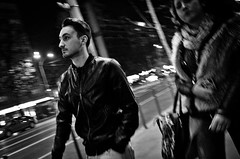 _DSC7790 (stimpsonjake) Tags: nikoncoolpixa 185mm streetphotography bucharest romania city candid blackandwhite bw monochrome youngman blurry leatherjacket furcoat night couple