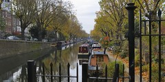 Autumn in Maida Vale - moored narrow boats, Regent's Canal, London W9 (edk7) Tags: nikond300 sigma2470mm128dghsmex edk7 2010 uk england london londonw9 cityofwestminster maidavale canal mooredboat regentscanal narrowboat canalnarrowboat ship vessel city cityscape urban house terrace car embankment gate fence tree cloud architecture building oldstructure