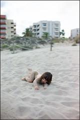 L getting sandy after his post beach shower. (Sapient Iguana) Tags: boy sea summer playing beach sand child play sandy playa lucianlanteri
