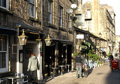 A Street in Harrogate (Tony Worrall) Tags: road uk england bar buildings town nice pub inn view place path candid yorkshire north visit scene tourist historic architcture sunlit harrogate quaint past spa peopl shoppers relic yorks spatown secnic oldn ©2014tonyworrall harrogatebuildings thealexandrastreet