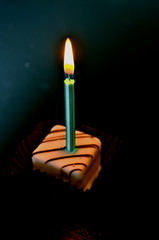 solitary wish (Alaskatohawaii) Tags: light cake horizontal contrast dark candle wish petitfours odc
