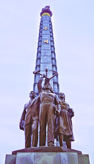 Juche Tower, Pyongyang (asenseof.wonder) Tags: panorama tower statue vertical bronze cloudy crossprocess overcast korea revolution tinted looming northkorea pyongyang dprk juche