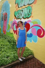 Grafitti Background (PhotoAmateur1) Tags: morning blue red portrait woman brown brick beautiful beauty smile face yellow wall female train silver hair neck skinny outside outdoors photography graffiti photo necklace am spring model eyes shoes shoot dress photoshoot arms top over young lips caboose brunette thin shoulder photosession slender