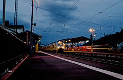 Remagen station by night (Ermintrude73) Tags: longexposure night train germany cloudy transport railway nighttime nightime lighttrails publictransport rhine rhein rheinland rhineland nocturnes remagen