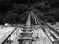 Just another bridge to cross (tim_k1) Tags: noedit artfilter jpeg sooc suspension wooden microfourthirds m43 pen omd em1 olympus f28 714mm pro monochrome bw blackandwhite wobbly river bridge asia walk trail hike trek trekking nepal annapurnasanctuary sanctuary annapurnabasecamp abc basecamp annapurna