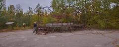 Pripyat Amusement Park (Chernobyl Exclusion Zone)_5 (Landie_Man) Tags: none pripyat chernobyl ionising radiation radioactive fair fairground amuse amusements amusement park may day parade soviet union ussr cccp disused abandoned forgotten left sad never opened ran communism communist fun ferris wheel bumper cars dodgems swing ride swings nature reclaim redstar red star cliche clche