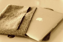 Apple MacBook Pro in Pouch - Must Link to https://thoroughlyreviewed.com (ThoroughlyReviewed) Tags: sepia apple macbook iphone computer laptop smartphone working work office indoor