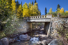 Bridge Over Autumn Waters (Striking Photography by Bo Insogna) Tags: bridges bridge rocks mountains fall foliage autumn golden aspentrees forest nature colorado rockymountains jamesinsogna rustic rural travel landscapes fineartphotography