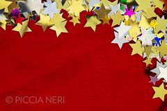 Colorful stars on red velvet background (PicciaNeri) Tags: glow festivities glitter ornate black xmas christmas decorative goldstar isolatedonblack starnight seasonal festive celebration text goldenstar birthday golden goldenconfetti goldenstars goldstars background celebrate sparkle confettistars blank december present holiday color winter border largegroupofobjects goldconfetti party greetings gold confetti star gift design small holidaycard blue colorful metallic dreams starshape copyspace aspirations decoration closeup card nobody message happy motif