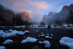 El Capitan Fire! (Mohanram Sathyanarayanan) Tags: yosemite alpenglow colors valleyview snow storm snowstorm foreground rocks nationalparks optoutside elcapitan valley nps cold mist fog orange wideangle scenic water river merced alpine winter thanksgiving