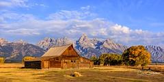 Homestead (craig goettsch) Tags: grandtetonnp wyoming mormonrow tamoulton barn autumn fallcolors mountains landscape nikon d810 blue clouds sky