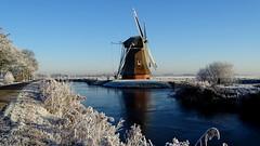 ZUIDWOLDE, THE NETHERLANDS (pwitterholt) Tags: krimstermolen zuidwolde groningen boterdiep mill winter windmill windmolen molen ijs ice water helder clear clearsky rijp whitefrost frost sony sonycybershot sonyhx400