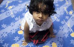 DSC_0158 (Tapas Biswas) Tags: life light portrait people india color colour girl face childhood kids female children kid nikon child image indian w portraiture hindu emotions bengali westbengal realpeople indiangirl nikond90 onlyindian nikod90 nikond9o