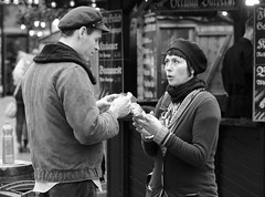 Rolling Up (Just Ard) Tags: street uk urban blackandwhite bw woman man hat wales photography nikon couple candid cardiff hats 85mm explore tobacco explored 85mm18d d7000 justard vision:people=099 vision:face=099 vision:outdoor=0817