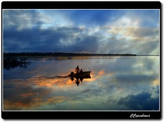 Catching the Last Glimpse (our cultural archive) Tags: sunset nature water reflections landscape boat florida gainesville newnanslake
