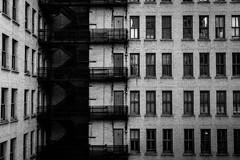 Windows and Shadows (Daveography.ca) Tags: old city windows bw building brick tower heritage wall stairs downtown edmonton shadows alberta fireescape mcleodbuilding vision:text=0707 vision:outdoor=0798 vision:street=0671 vision:sky=0588