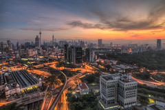 Once Upon a Time in Kuala Lumpur. (Azihan Yusoff) Tags: city morning travel light sky urban skyscraper sunrise buildings nikon cityscape view state transport skylines dramatic burningsky kualalumpur vistas moment metropolitan hdr klcc urbanscape twintower morningsky kltower lighttrail menarakualalumpur nikond80 visitmalaysia impressedbeauty amazingmalaysia azihanyusoff