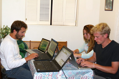 Mike, Antonella, and Perry processing data