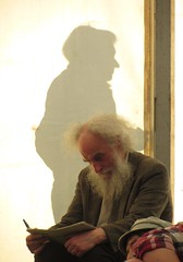 Ghost and beard (shaggy359) Tags: cambridge shadow white man festival pen paper beard reading newspaper strawberry free fair tent read bearded cambridgeshire balding concentrate 2014 concentrating cambs