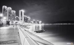 Nightly Qiantangjiang (Andy Brandl (PhotonMix.com)) Tags: night bw monochrome highrises boats qiantangjiang river riverside lights longexposure hangzhou photonmix urban zhejiang