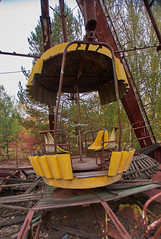 Pripyat Amusement Park (Chernobyl Exclusion Zone)_1 (Landie_Man) Tags: none pripyat chernobyl ionising radiation radioactive fair fairground amuse amusements amusement park may day parade soviet union ussr cccp disused abandoned forgotten left sad never opened ran communism communist fun ferris wheel bumper cars dodgems swing ride swings nature reclaim redstar red star cliche clche