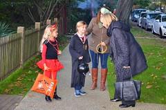 Greeting People On Halloween (Joe Shlabotnik) Tags: 2016 costumes violet devil lily october2016 hermione sarahp halloween afsdxvrzoomnikkor18105mmf3556ged