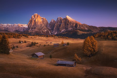 The Peaceful Valley (albert dros) Tags: alpenglow autumn dolomites serenity alpedisiusi travel houses albertdros mountains italy huts hills peaceful bluehour rocks