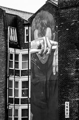 hanging despair monochrome (PDKImages) Tags: art street manchesterstreetgallery manchesterstreetart streetart contrasts couple love artinthecity ripartist faces abandoned girl bee bees manchester walls posterart stencilart heart hidden dmstff cityscape cityscene
